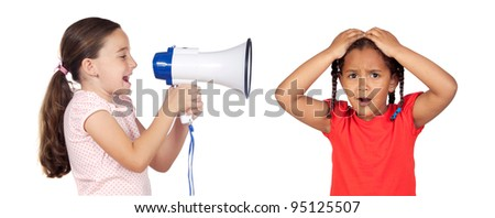 Little girl shouting through megaphone and a african baby isolated over white