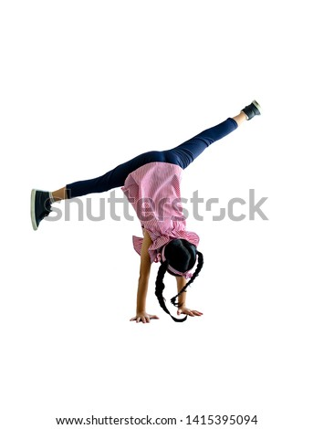 Little girl show for turn a somersault with isolated on white #1415395094