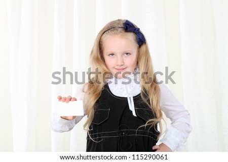Little girl shows business card