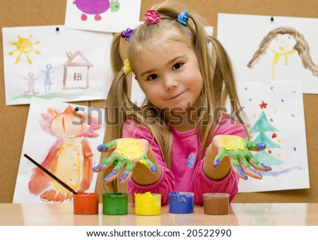 Little girl shows her painted hands