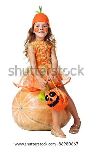 Little girl sits on a pumpkin. Isolated over white