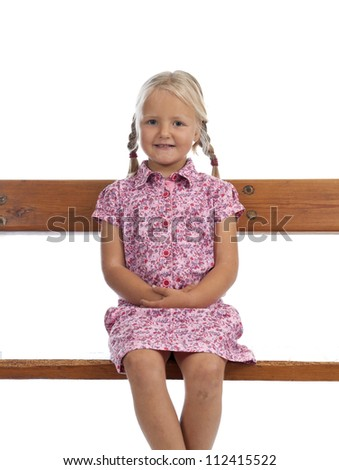 little girl sitting on a bench