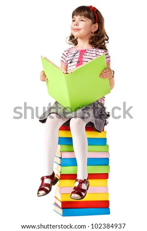 Little girl sitting on stack of books. Isolated