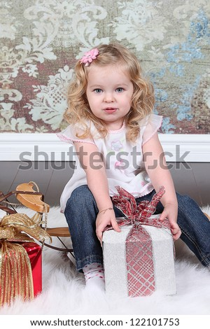 Little Girl Sitting on Suitcase