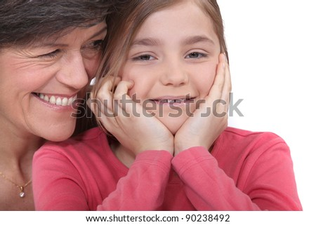 Little girl sitting with her grandmother