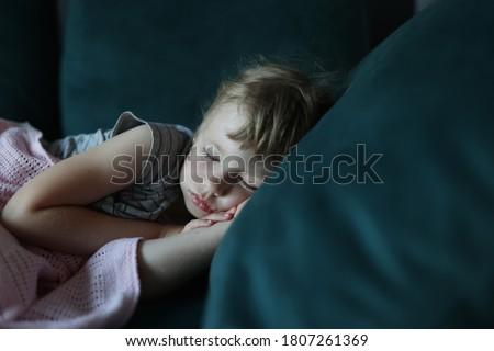 Little girl sleeps in her bed in bedroom. Children's dreams concept Stock fotó ©