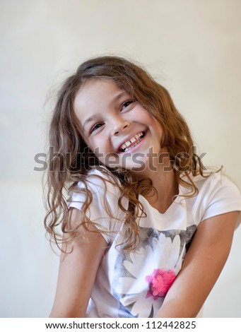 Little girl  smiles at the camera.