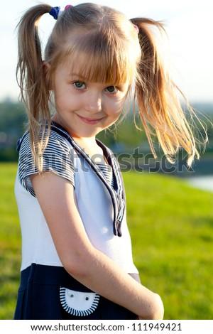 Little girl smiling  closeup - stock photo