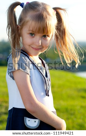 Little girl smiling  outdoors portrait