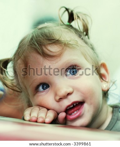 Little girl smiling with a sweet face expression Baby girl happy portrait