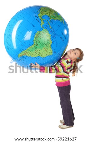 little girl standing and holding big inflatable globe over her head, side view, looking at camera, isolated on white