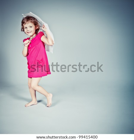 Little Girl standing with umbrella