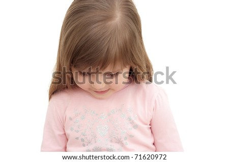 little girl stands and hung her head