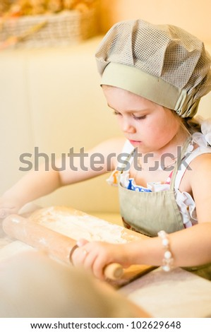 Little girl start cooking pizza and working with dough