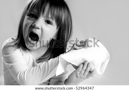 little girl surprised. holding roll of  toilet paper