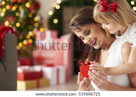 Little girl surprises mummy by giving present #519606721