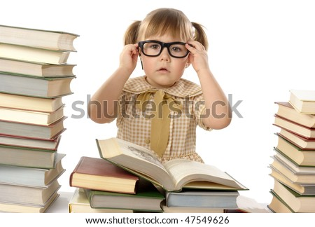 Little girl surrounded by books wearing black glasses, back to school concept, isolated over white - stock photo