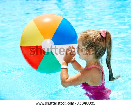 Little girl  swimming in pool.