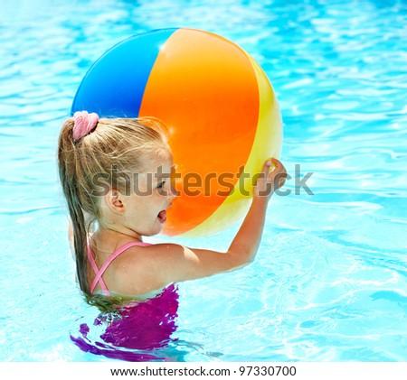 Little girl  swimming in pool. - stock photo