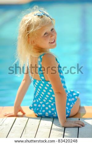 little girl swims in pool - stock photo