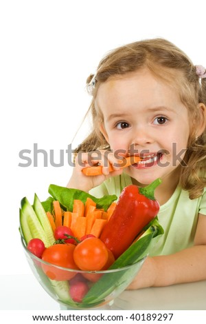 Little girl tasting and chomping a carrot - isolated