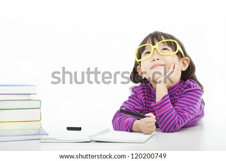little girl  thinking or dreaming during preparing homework