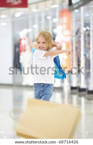 Little girl throws away from shopping bags