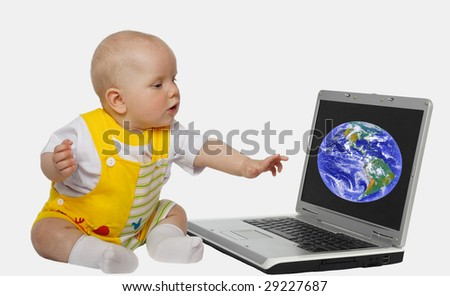 little girl touching screen on the laptop
