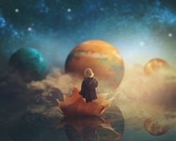 Little girl travelling through dream world, floating on a big fallen leaf; imaginationfantasy background; Elements of this image furnished by NASA