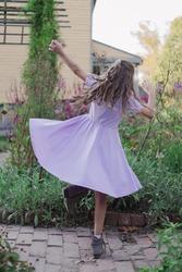 Little Girl Twirling in a Dress