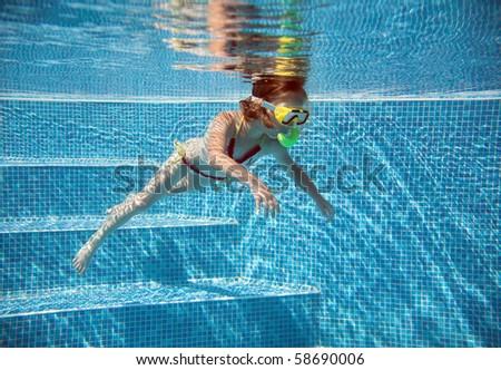 Little girl under water in pool