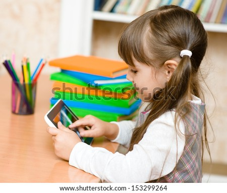 little girl using tablet computer