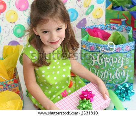 stock-photo-little-girl-waiting-to-open-her-birthday-present-2531810.jpg