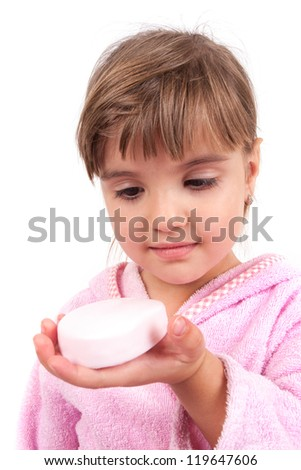 Little girl washing hand and face