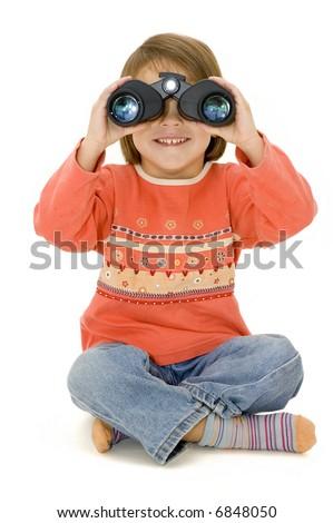 little girl watching with binoculars