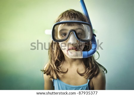 Little girl wearing a diving mask