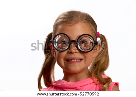 Little girl wearing big round glasses and smiling