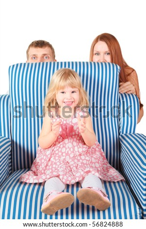 little girl wearing dress, pantyhose and shoes is sitting on char. father and mother behind her. focus on little girl's face. isolated.