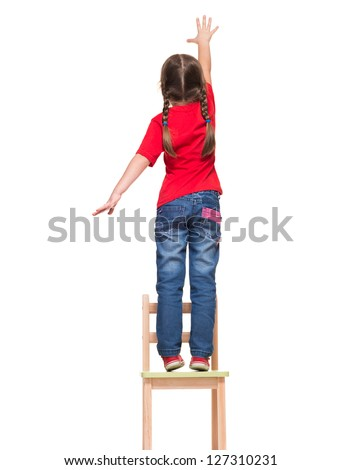 little girl wearing red t-shirt and reaching out something up high on white background