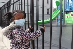 Little Girl wearing Surgical Mask on Playground