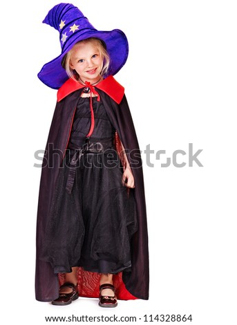 Little girl wearing witch costume.
