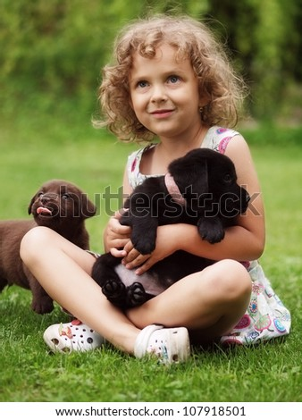 Little girl wit puppy