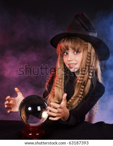 Little girl witch holding crystal ball.