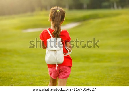 5f60e0070f ... coat and french beret run to school · Little girl with a backpack going  to school. back view  1169864827