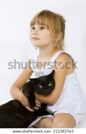 little girl with a black cat (child and pet)