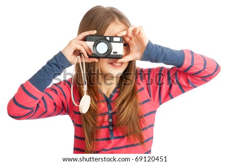 Little girl with a camera on a white