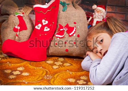 little girl with a Christmas gift - stock photo