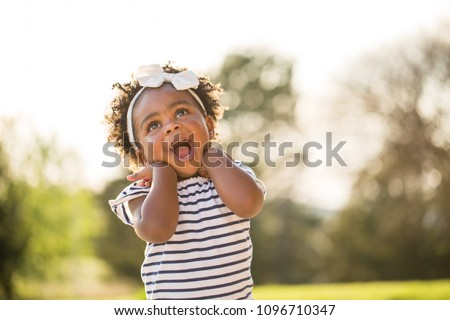 Little girl with a cute expression. #1096710347