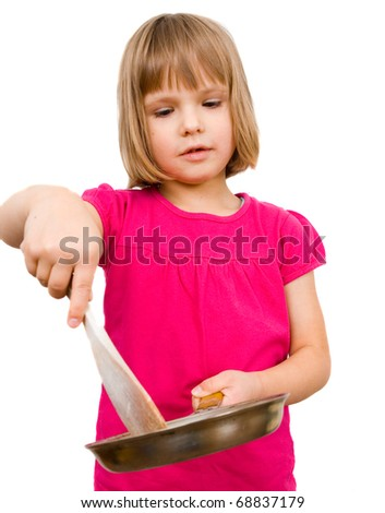 little girl with a frying pan