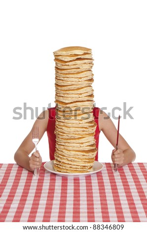 Little girl with a giant plate of pancakes, a knife and fork on a table cloth.